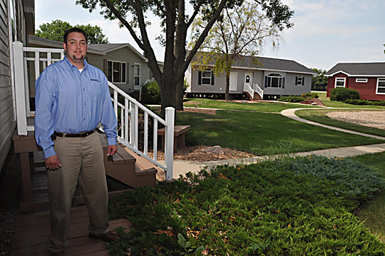 Brett Chlebecek of Centennial Homes in Aberdeen shows some of the homes that the business makes and sells. The homes are set up on U.S. Highway 281 South. The homes are made in Montevideo, Minn.