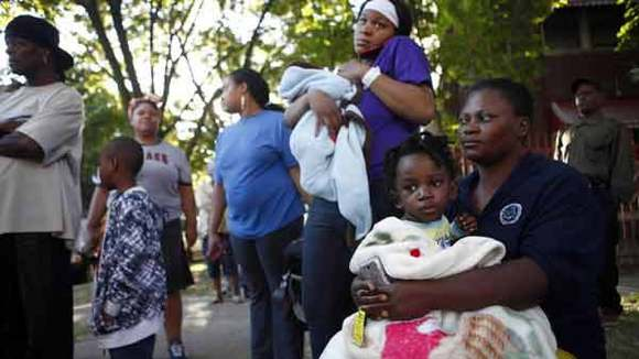Henrietta Ofili, 41, and her 2-year-old son Samuel after fleeing fire.