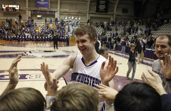 John Shurna celebrates with fans after Northwestern's win over Akron in NIT in March.