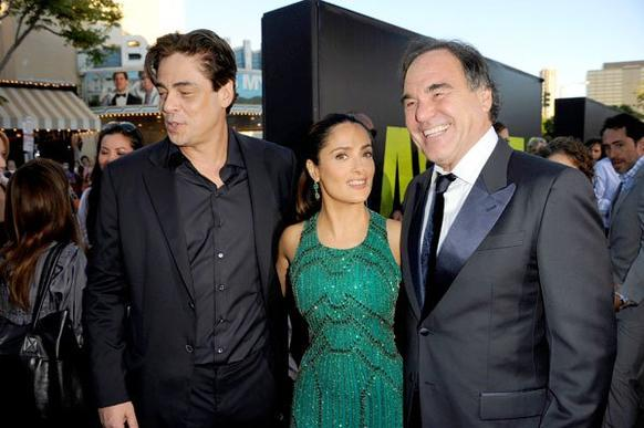 "<em>Actors Benicio Del Toro, left, Salma Hayek and director  Oliver Stone arrive at the premiere of ""Savages.""</em><br><br> Director Oliver Stone's ""Savages"" takes place in Laguna Beach, where young entrepreneurs Ben and Chon create a lucrative marijuana business. When Mexican drug cartel Baja Cartel asks for a partnership and is denied,  kidnapping and violence follow. Click through the gallery to see photos from the premiere at Westwood Village."