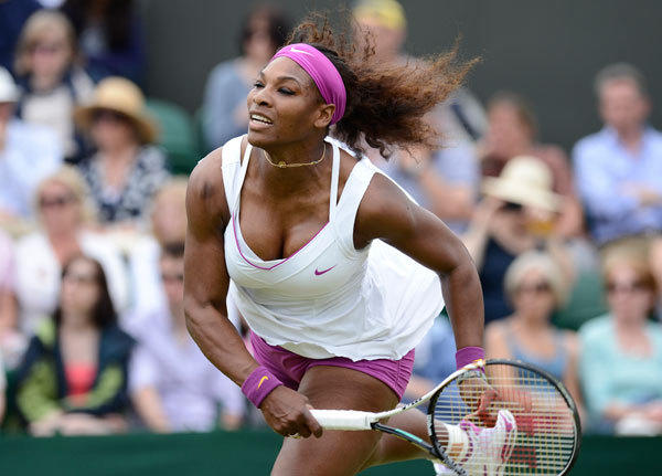 Serena Williams of the U.S. hits a return to Barbora Zahlavova Strycova of the Czech Republic during their women's singles tennis match at the Wimbledon tennis championships in London June 26, 2012.