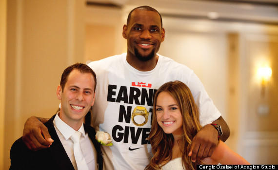 LeBron James poses with a couple that is about to get married.