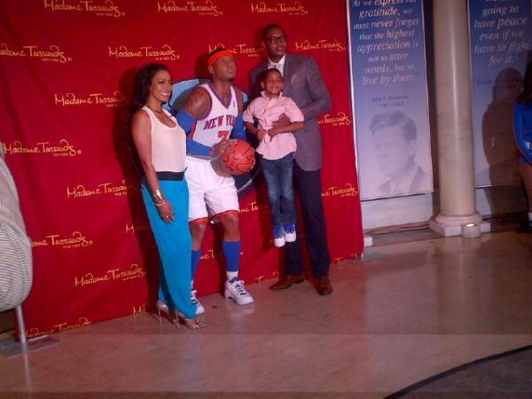 Carmelo Anthony checks out his waxy replica with his family, including wife, La La.