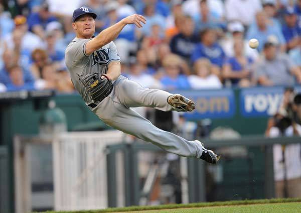 Tampa Bay Rays third basemen Brooks Conrad (36) makes a throw to first base against the Kansas City Royals during the third inning at Kauffman Stadium.