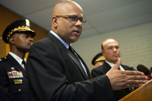 Ceasefire representative Tio Hardiman, center, Chicago Police First Deputy Superintendent Alfonza Wysinger, left, and Dr.Gary Slutkin, right, announce details of a new pilot program to address gang-related violence in three districts on Chicago. The City of Chicago awarded a one-year $1 million grant to Chicago Project for Violence Prevention.