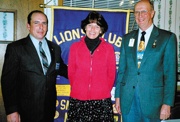 Immediate Past District Gov. Richard Libneo, right, recently inducted Tina Davis, center, as the newest member of the Smithsburg Lions Club. Eric Davis, her sponsor, is at left.