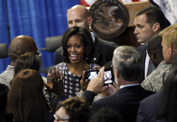 First Lady Michelle Obama greets people after she joined Gov. Pat Quinn as he signed the Military Family Licensing Act into law. (Brian Cassella/Chicago Tribune)