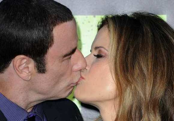 "John Travolta showed no signs of stress at the ""Savages"" premiere despite recent sexual harassment accusations."