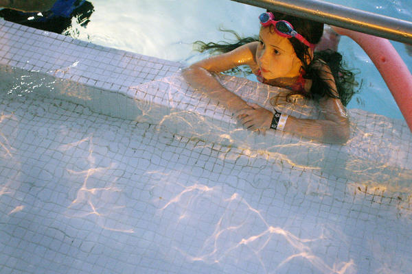 Mckenna Dahlen, 7, watches Dolphin Tales during Dive-In Movie Night, which took place at the Rose Bowl Aquatics Center in Pasadena on Saturday, June 23, 2012.