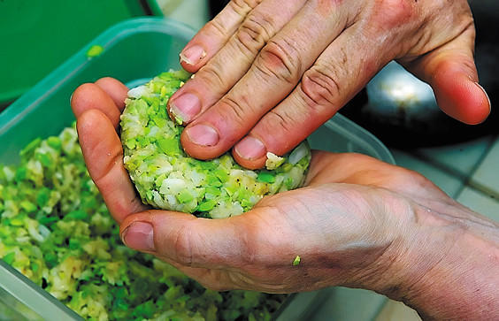 Pam Smith makes an Asian edamame burger at her cafe. She says she makes about 10 different types of burgers.