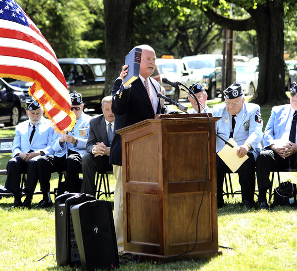 State Del. John Donoghue, D-Washington, speaks during a groundbreaking ceremony for the Korean War monument at Mealey Parkway in Hagerstown. He quoted phrases from a book of speeches by the late President John F. Kennedy.