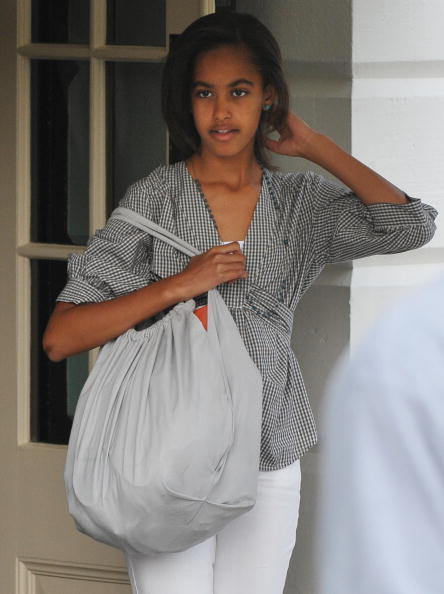 "Presidential daughter <a class=""taxInlineTagLink"" id=""PECLB004380"" title=""Malia Obama"" href=""/topic/politics/malia-obama-PECLB004380.topic"">Malia Obama</a> is 13."