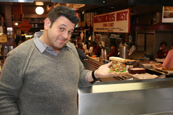 Adam Richman with Faidley's famed sandwich