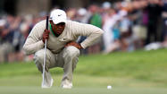 Tiger Woods doesn't expect putting woes to last