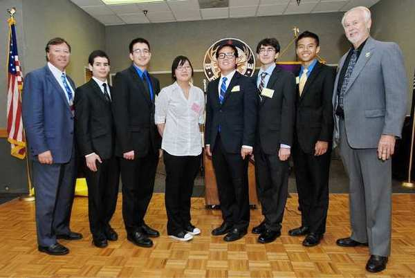 Glendale Elks Exalted Ruler Rick Adams, from left,Êwith scholarship recipients Manuk Hovanesian (UC Berkeley), Steven Ghazikhanian (Duke University), Julia Lim (University of the Pacific), Jacob Kim (Harvard), Yervand Azatian (USC), Justin Sao (Stanford) and Scholarship Chairman Jack Wright.