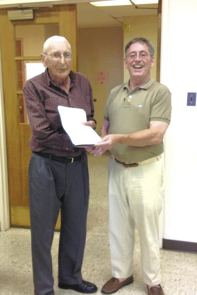 "Harold ""Jiggs"" Kennedy, left, receives recognition from Chambersburg (Pa.) Borough Council President William McLaughlin to commemorate his retirement at age 93."