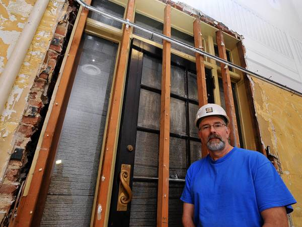 Job supervisor Bill Lutterschmidt stands in front of a historic door that he discovered behind a wall while renovating the Allentown Symphony Hall box office. Symphony Hall is investigating its historical significance and is going to try to incorporate the door into the expansion.