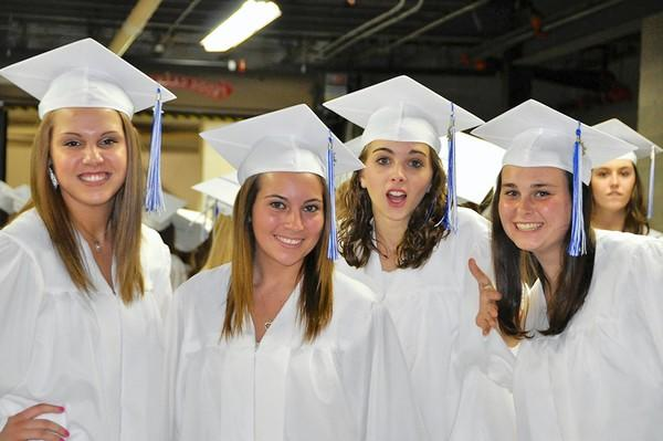 Some Quakertown High School seniors are all smiles on graduation night.