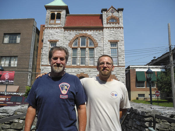 Kenneth Bruce, right, poses with volunteer firefighter Chuck Harold in front of Antietam Volunteer Fire Co. No. 2 on Summit Avenue in Hagerstown. Bruce stopped in Hagerstown recently during his walk across the Northeast to raise awareness about the needs of homeless military veterans.