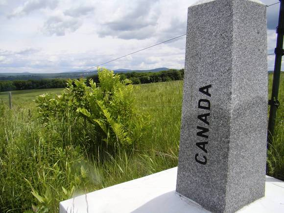 A granite marker near Stanstead, Quebec, identifies the international border between Canada and the United States
