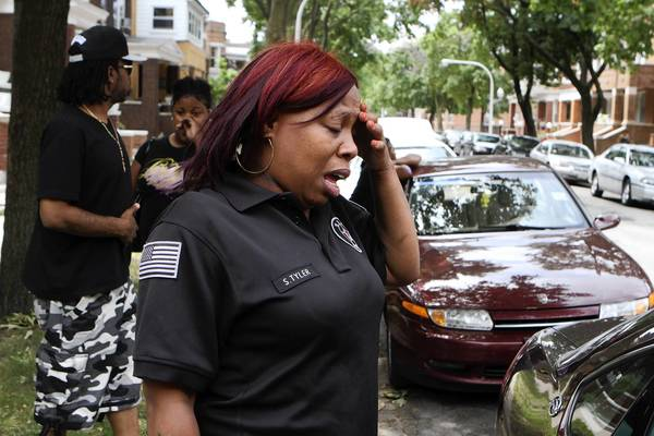 Sandra Tyler, Tyquan's mother, is overcome as she describes holding her son, the victim of a drive-by shooting, as his life poured away.