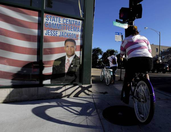A bicycle rider pedals past the South Side site of Rep. Jesse Jackson Jr.'s Chicago office at East 71st Street and South Yates Boulevard. The congressman has taken a medical leave of absence, citing exhaustion.
