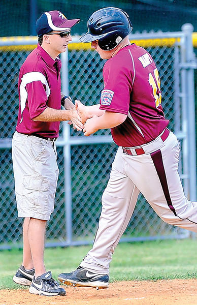Maugansville's Brandon Haupt gets congratulated as he rounds third after a solo home run - his first of two in the game - in the third inning to lead his team to a 9-5 victory over Conococheague in the opening round of the Maryland District 1 Senior League tournament.