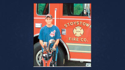Stoystown firefighter Cory Johnson poses with a set of golf clubs.