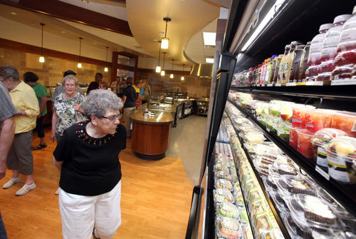 Mavis Kirschenman, of Aberdeen, looks over the food offerings in the dining facility at Sanford Aberdeen Medical Center during Tuesday's open house. Kirschenman, who said she lives near the hospital, said she might come by to eat sometime. photo by john davis taken 6/26/2012
