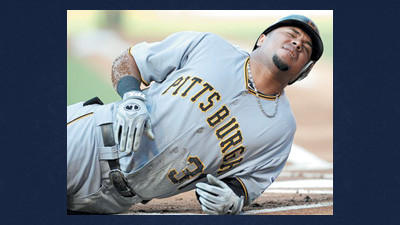 Pittsburgh Pirates' Jose Tabata grimaces in pain after getting hit with a pitch from Philadelphia Phillies' Vance Worley in the first inning of a baseball game Tuesday in Philadelphia.