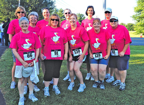 This group of women who completed the Children's Village 5-K included, front row, from left, Susan Layos, Laurie Metz, Kristy Smith, Melissa Slifer and Brenda Dellinger. Back row, Alisa Friend, Karen Cunningham, Stacey Haupt, Lauri Neubauer, Paula Ford and Jane Henry.