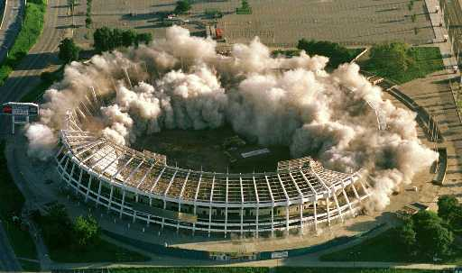 Atlanta-Fulton County Stadium begins to fall after 350 pounds of explosives detonate on August 2 in Atlanta. The stadium, which was built in 1965 and was the home of the Atlanta Braves, Atlanta Falcons and a Centennial Olympic venue, was demolished to make room for parking for Turner Field, the new home of the Braves.