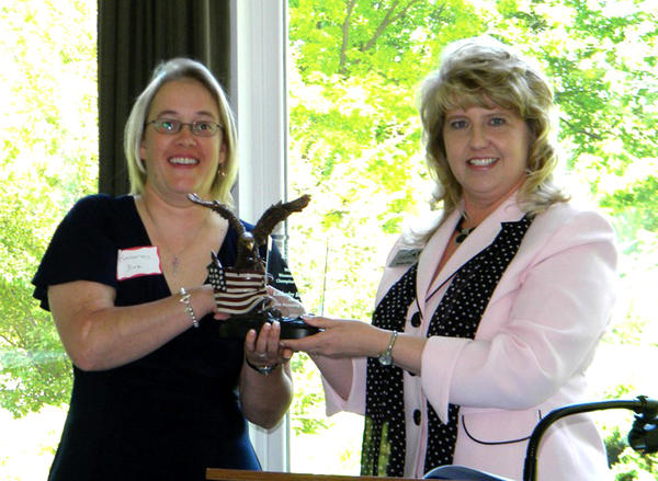 Kimberley Beth Dole, left, owner of Dole Accounting Services, receives the 2012 Women in Business Champion Award from Karen Friel, acting director of the U.S. Small Business Administrations West Virginia district office.