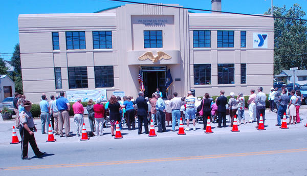 A crowd gathers Tuesday along College Street in Harrodsburg to watch Gov. Steve Beshear present $500,000 that will be used to upgrade the Wilderness Trace Family YMCA building to include a wellness center.
