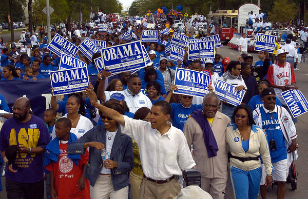 State Sen. Barack Obama, with wife Michelle, gets a big welcome at the Bud Billiken Day parade in 2004.