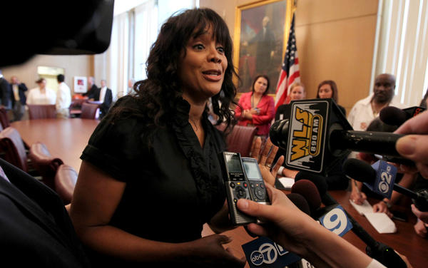 Ald. Sandi Jackson, 7th, talks to reporters outside City Council chambers on Wednesday.
