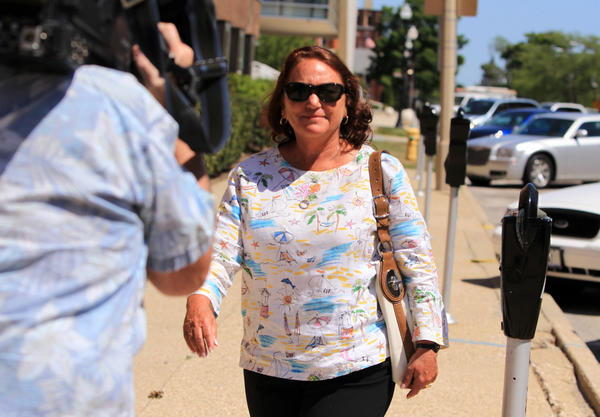 Illinois State Sen. Suzi Schmidt (R), Lake Villa , leaves the Lake County Courthouse following her arraignment today on charges of criminal damage to property and trespassing.