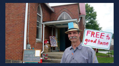 """Jay Best welcomes visitors to last year's Big Fat Yard Sale. His hat reads """"Make Me an Offer!"""" The yard sale is one of several fun events happening in Confluence this weekend."""