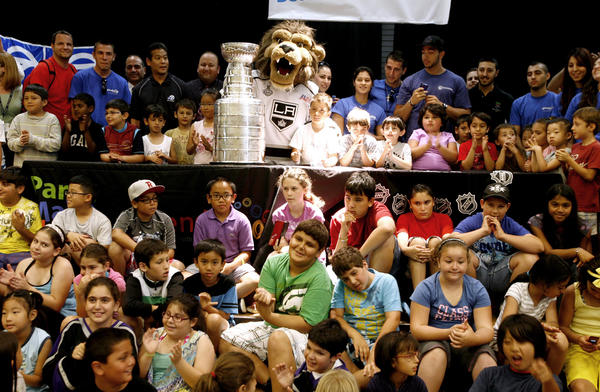Children got to pose with the Stanley Cup, National Hockey League's Championship trophy, during visit to Pacific Community Center and Park Gymnasium in Glendale on Wednesday, June 27, 2012. Hundreds showed up to get a close view of the trophy.