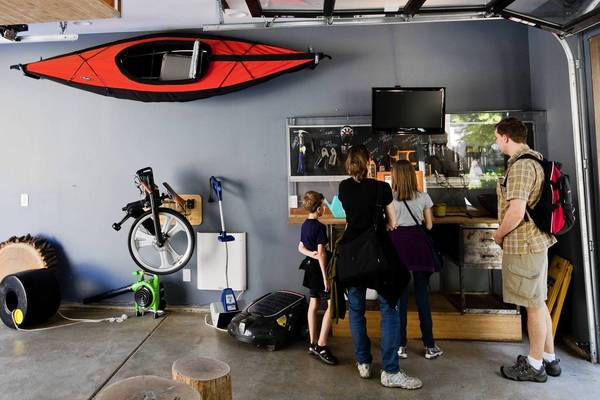 Bryce and Kelly Pier, of Mineapolis, Minn., with their children Brennan, 7 and Menolly, 11, tour garage at the Smart Home exhibit at the Museum of Science and Industry in Chicago.