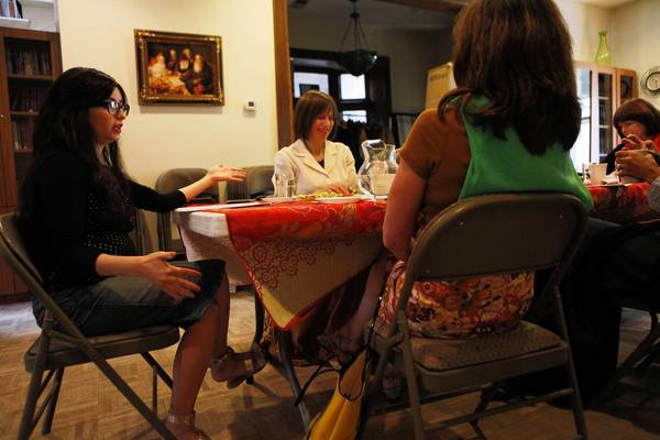 Chaya Moscowitz, left, daughter of Rabbi Meir Chai Benhiyoun, leads a study group for women Tuesday at the Chabad House of the Loop. The house, which is both a spiritual center and the home of the rabbi's family, is in foreclosure and slated to be auctioned Wednesday.