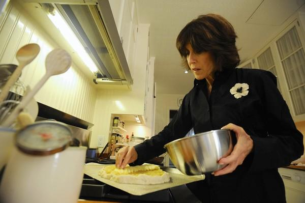 "Nora Ephron makes an apple tart at her New York home in 2009 amid the release of ""Julie & Julia."""
