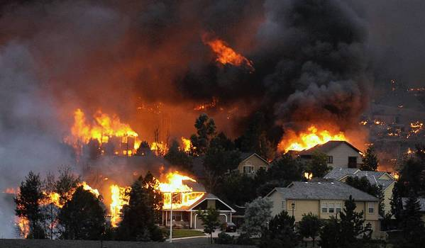 The Waldo Canyon fire roars through a neighboord in the foothills near Colorado Springs, Colo.