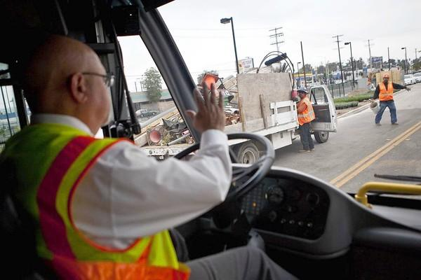Danny Ronge, a Metro instructor, drives a rapid bus along the new Orange Line extension in the Valley. The line opens June 30.