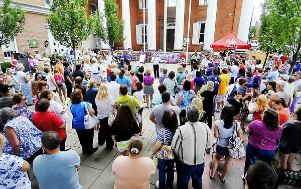 A huge crowd of Chambersburg (Pa.) Hospital employees gather for a rally Wednesday in front of the old Franklin County Courthouse in Chambersburg. Employee unions and the hospital are negotiating a new contract to replace one that expires Saturday.
