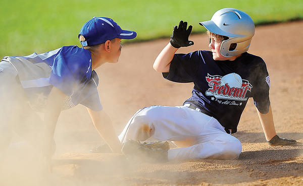 Federal's Dylan Watson, right, calls for time after sliding into third base safely, just beating the tag of Valley's Donny Borum on Wednesday during the third inning of the Maryland District 1 9-10 tournament winners' bracket final. Federal scored a 20-8 win to move into the championship round.