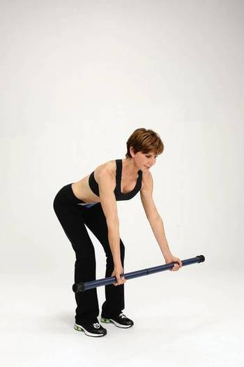 B. Maintaining a long, straight spine lower the weight until your arms are fully extended below your chest.