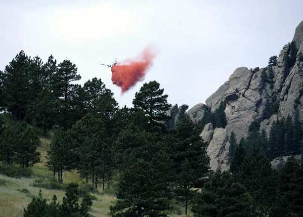 A tanker drops fire retardant near Bear Peak while battling a blaze near Boulder, Colo.
