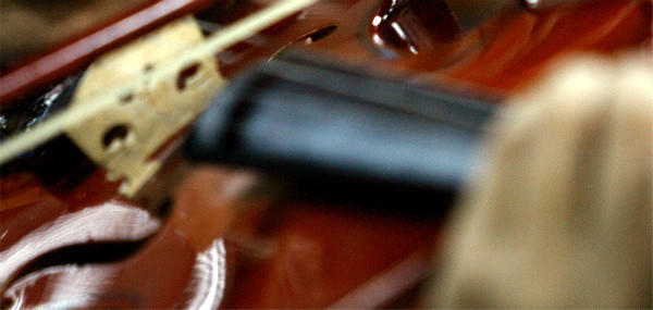 A student in the El Sistema program in Venezuela performs the violin.