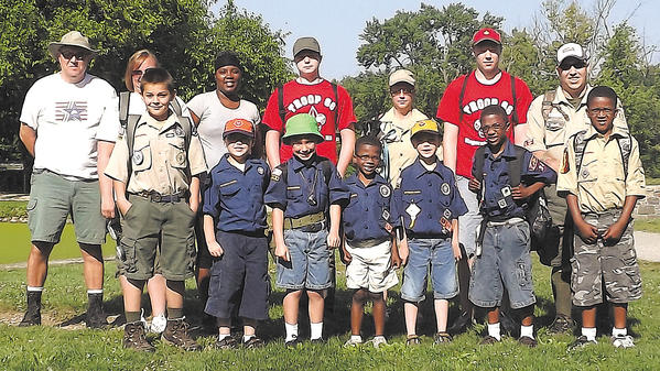 Cub Scout Pack 34 members from Christ Evangelical Lutheran Church in Hagerstown hiked a portion of the Chesapeake and Ohio Canal towpath at the Cushwa Basin in Williamsport on June 16. Front row, from left, Sean Maguire, TI Morris, Dane Arasmith, Dashawn Napier, TJ Morris, Devon Napier and Darin Saunders. Second row, Scot Arasmith, Michele Taylor, Ebony Styles, Michael Milner, Christina Morris, Thomas Milner and Bill Taylor.